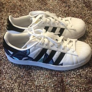 Women's white adidas shoes with floral pattern